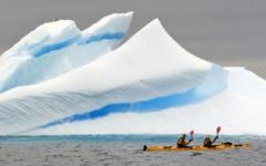 Kayaking next to huge glaciers
